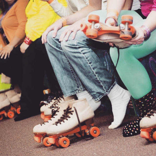 people putting on roller skates